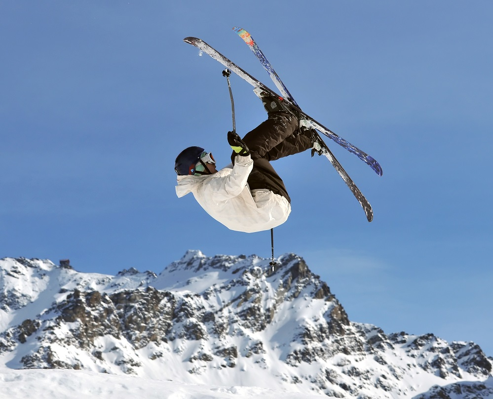 A free-ride jumper performs a high jump in the Verbier resort in Switzerland